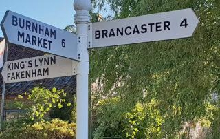 Signpost to Brancaster, Burnham Market, King's Lynn and Fakenham.